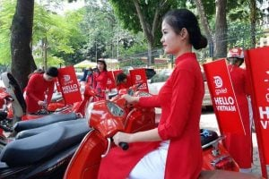 a-woman–wearing-the-traditional-vietnamese-long-dress–quot-ao-dai-quot—promotes-go-viet–the-vietnamese-version-of-the-indonesian-gojek-company–during-its-launch-ceremony-in-hanoi-4